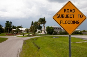 Flood signage in Florida. Signs, flooding, road.  UF/IFAS Photo by Tyler Jones.